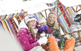 Friends Smiling in the Snow at the Ski Beach in Canyons Village