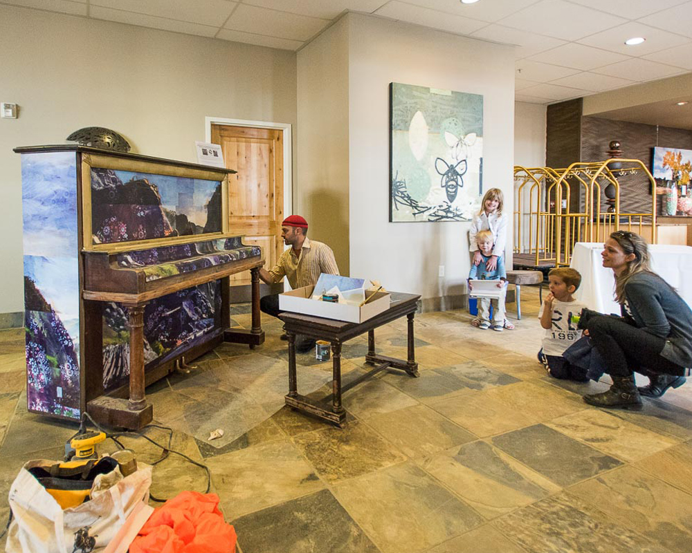 Man Painting on an Old Piano for Non Profit Art Pianos for All in Park City, Utah