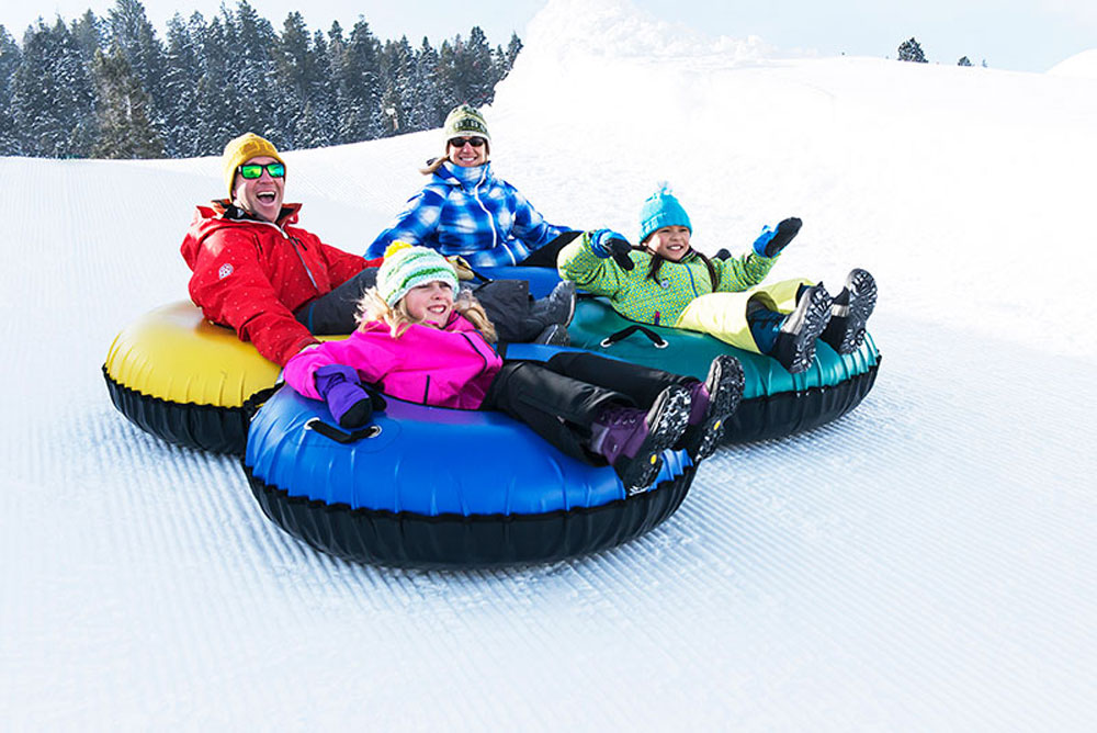 Family Tubing Down Slope in Park City