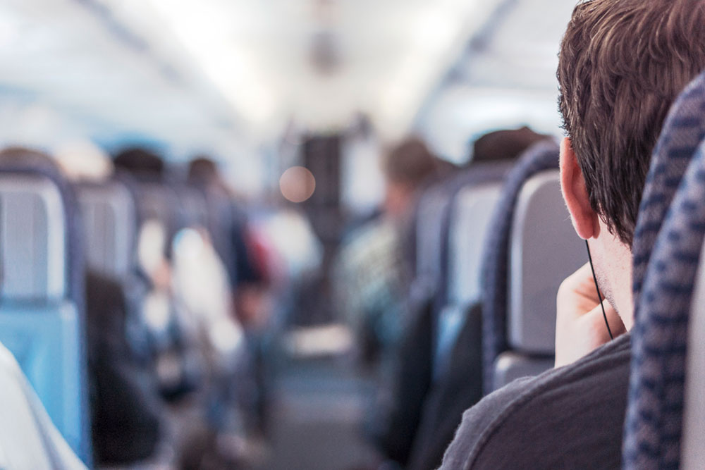 Man in Seat on Plane
