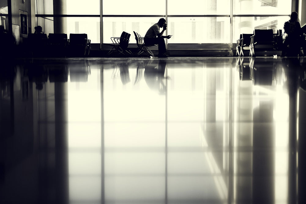 Man Waiting to Board Plane in Airport