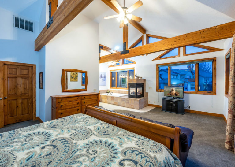 Master Bedroom Suite with Exposed Beams at Bear Hollow Private Home in Park City Utah