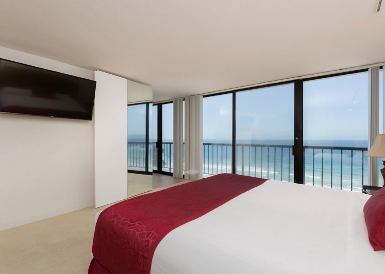 Bedroom with Balcony and Ocean View at Capri by the Sea in San Diego, California