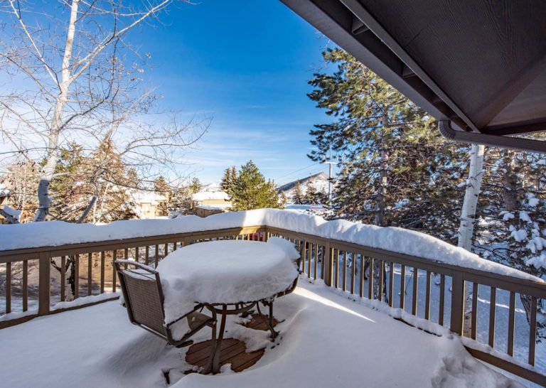 Upstairs Porch with Seating Area Covered in Snow at Hidden Creek Condominiums in Park City, Utah