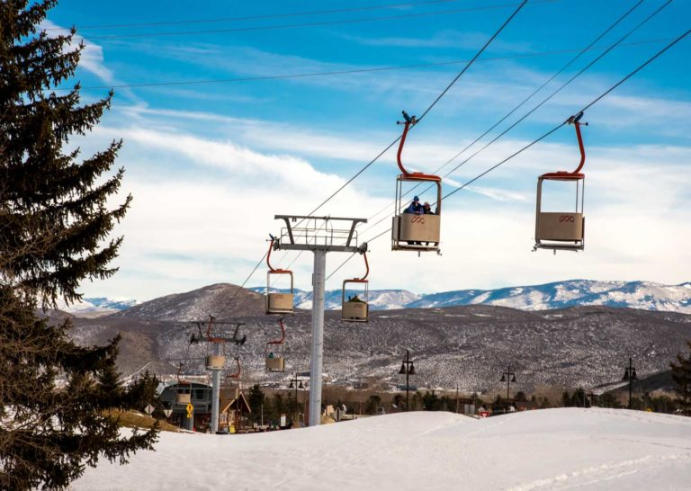 Skiers Riding in the Cabriolet Towards the Mountain Village in Park City Utah