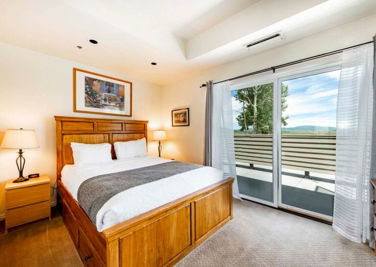 A two-bedroom condominium bedroom at The Lodge at the Mountain Village