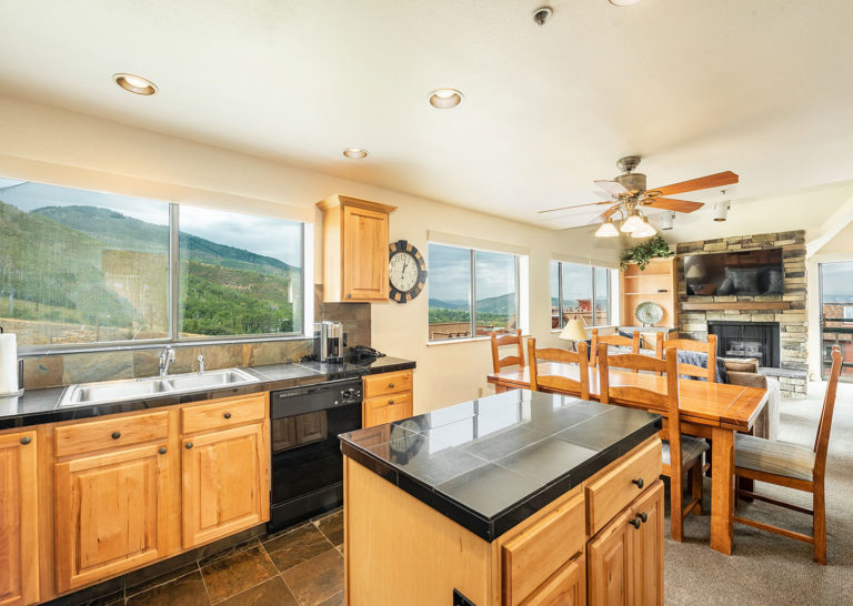Kitchen with Island and Dining Table at The Loft at the Mountain Village in Park City, Utah