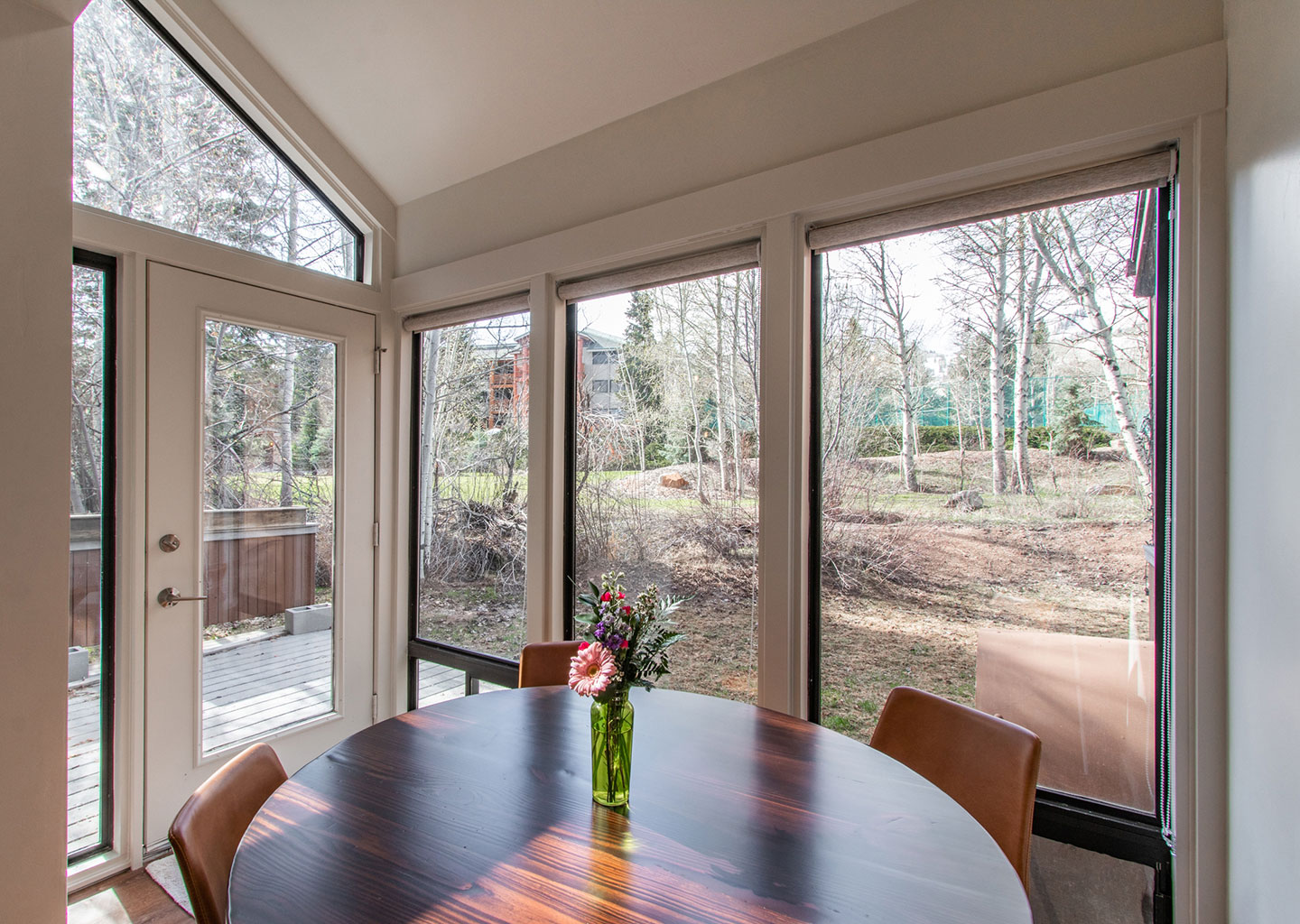 Circular Dining Table Surrounded by Windows at Three Kings Condominiums in Downtown Park City, Utah