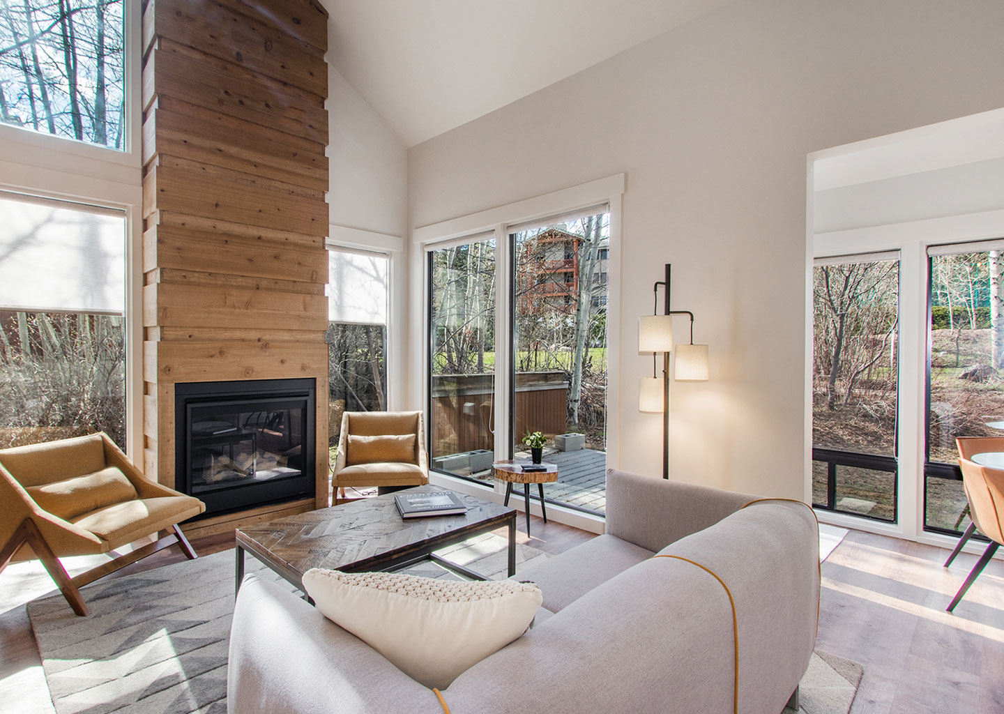 Stylish Living Room with Tall Wood Fireplace at Three Kings Condominiums in Downtown Park City, Utah