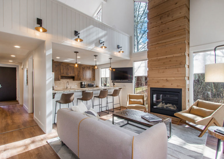 Stylish Living Room with Kitchen and Large Wood Fireplace at Three Kings Condominiums in Downtown Park City, Utah