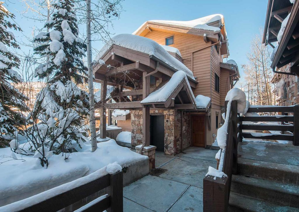 Snowy Building Exterior at Portico Townhome in Park City Utah