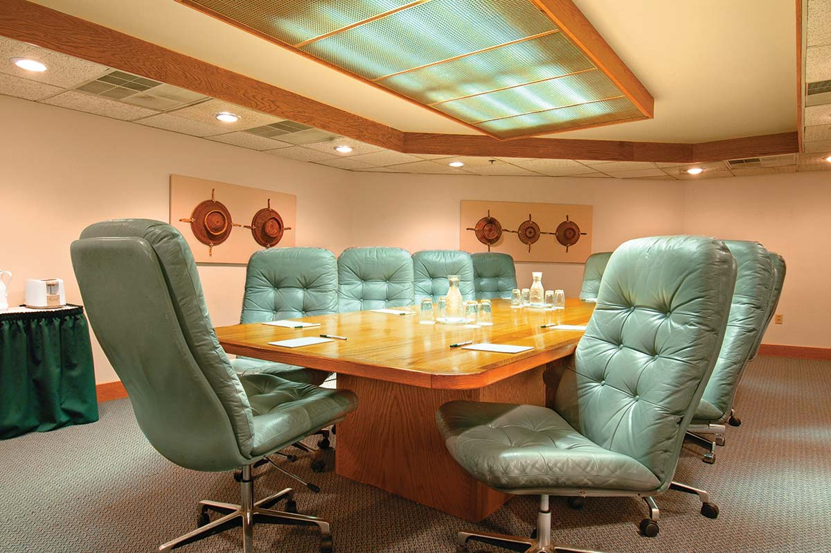 green swivel chairs in an executive meeting room in silver king park city