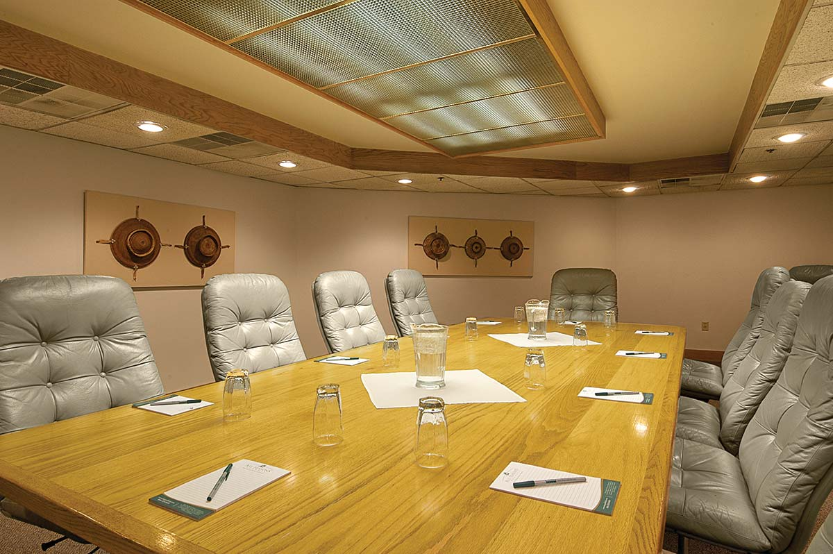 grey swivel chairs around a long executive table in a meeting room in park city