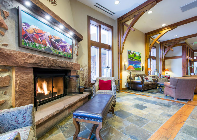 Lobby with Large Fireplace and Exposed Beams at Sundial Lodge in Canyons Village