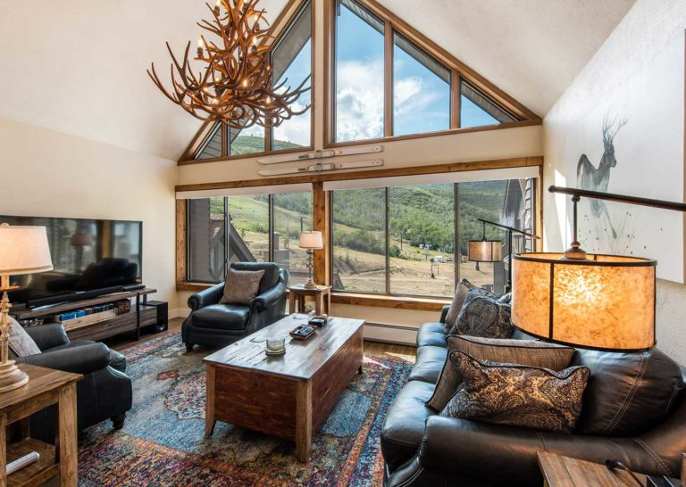 Living Room with Vaulted Ceilings and Large Windows at The Lodge at the Mountain Village