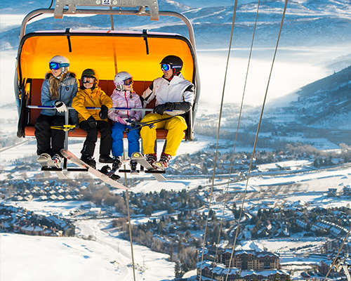 Family in Orange Bubble Lift Overlooking Canyons Village in Park City Utah