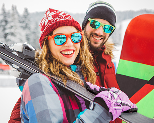 Couple with Ski Gear Smiling