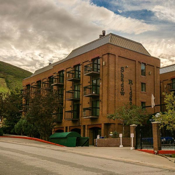 three story brick building named shadow ridge in park city