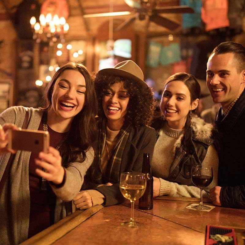 Group Taking a Selfie in a Bar
