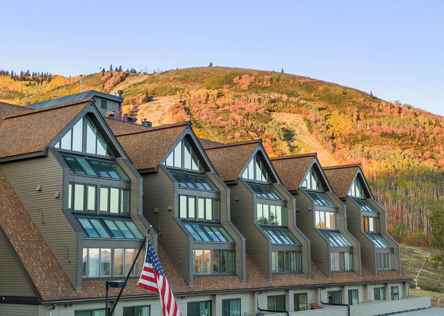 lodge at the mountain village in fall in the setting sun