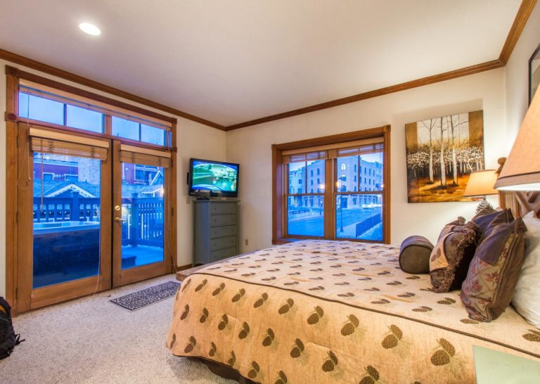 Master Bedroom at Town Lift Condominium with Hot Tub on Porch and View of Main Street Park City