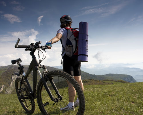 Man with a Yoga Mat and a Bike