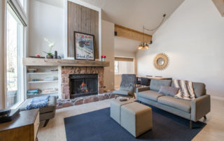 Bright, Contemporary Living Room with Stone Fireplace at Three Kings Condominiums in Downtown Park City, Utah