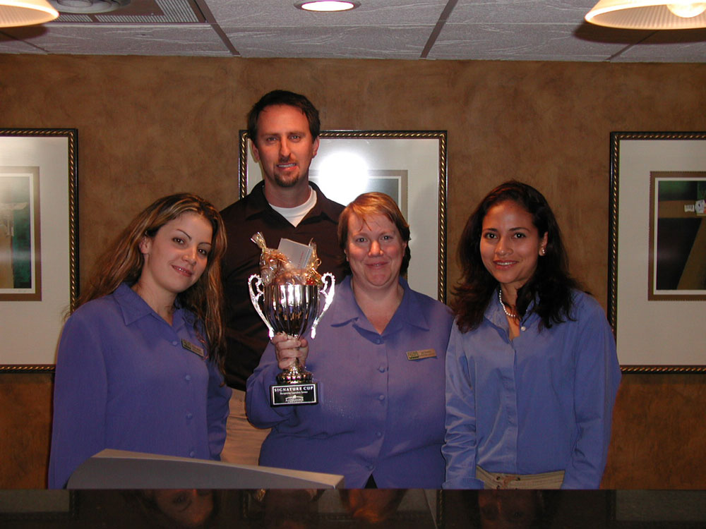 Happy Employees with Trophy