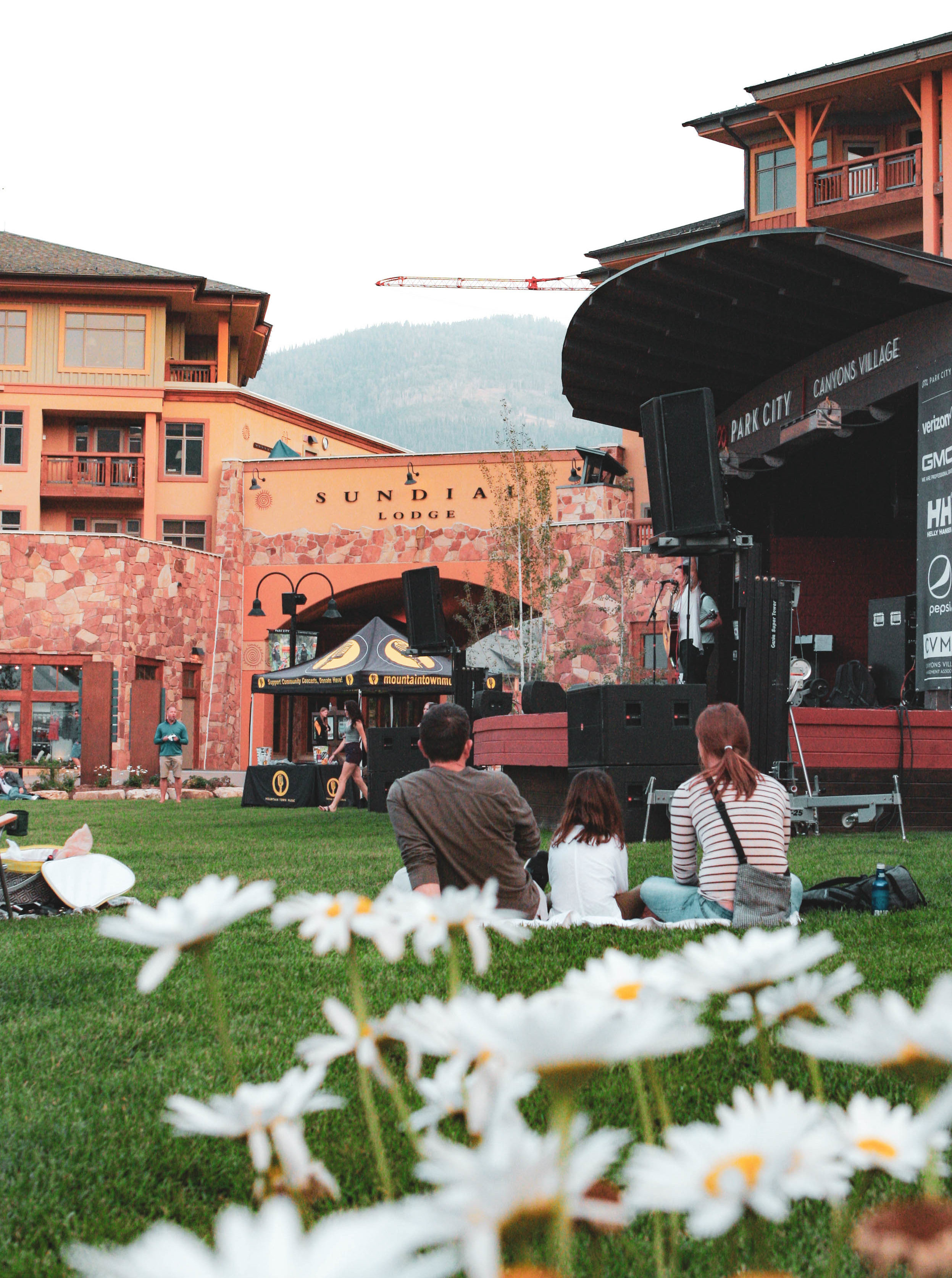 Family Sitting on the Lawn and Enjoying a Summer Outdoor Concert at Sundial Lodge