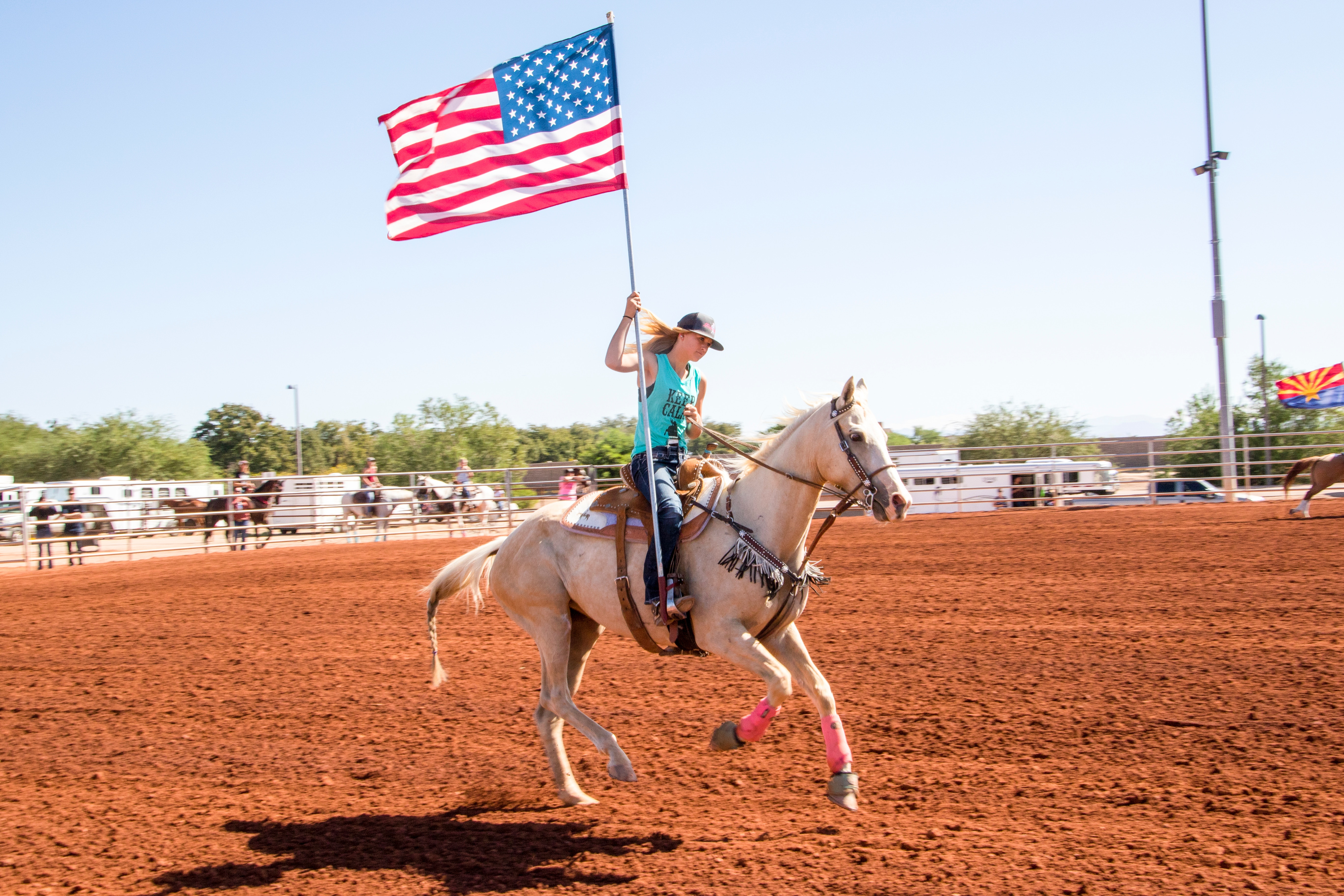 Woman Riding a Horse Carrying the American Flag
