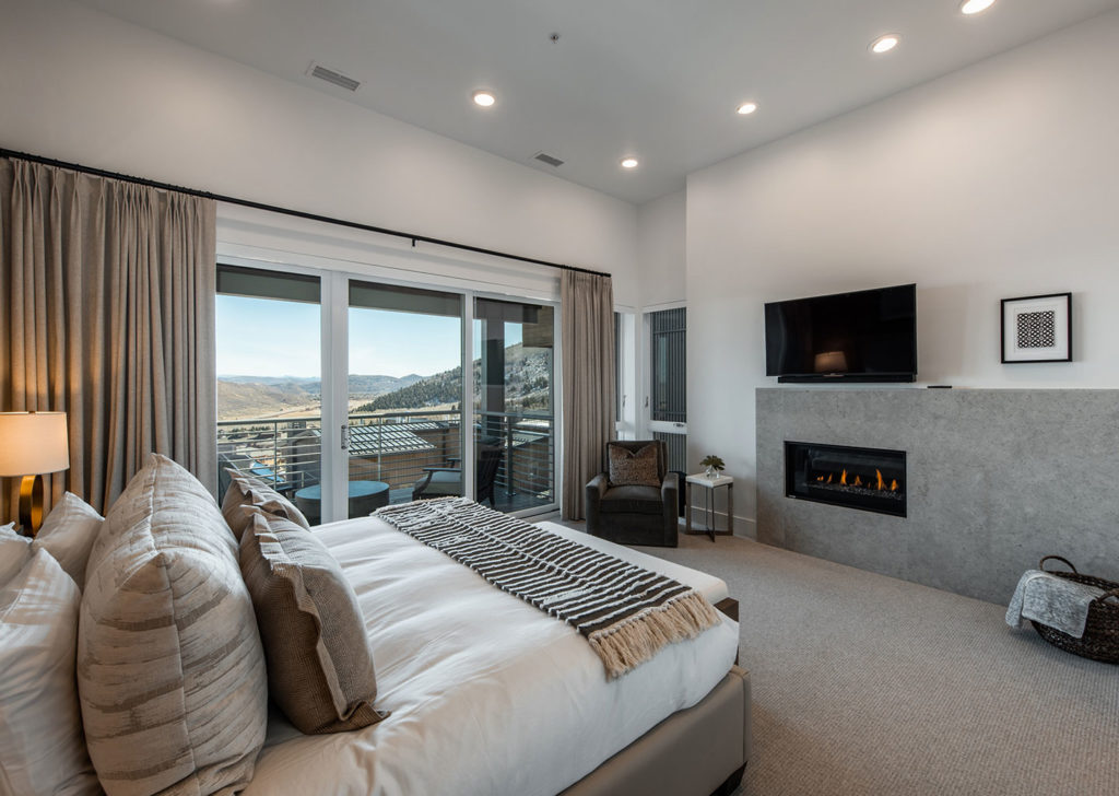 Master Bedroom with Electric Fireplace and Balcony at Apex Residences in Park City Utah