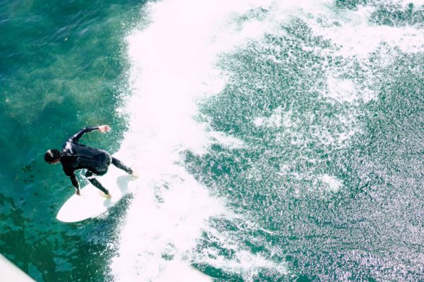 Aerial of Man Surfing a Wave
