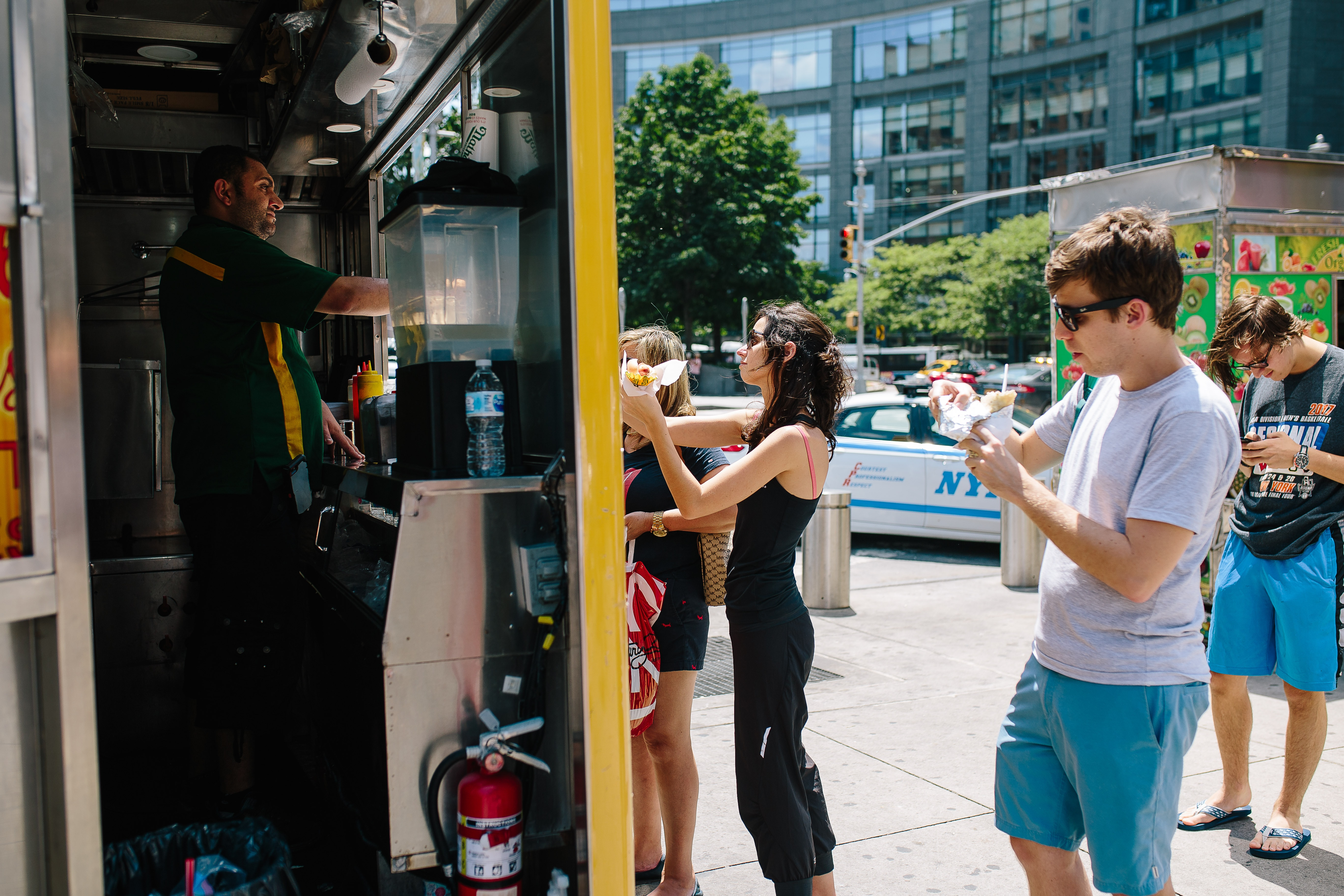 Customers Wait for Their Food at a Food Truck