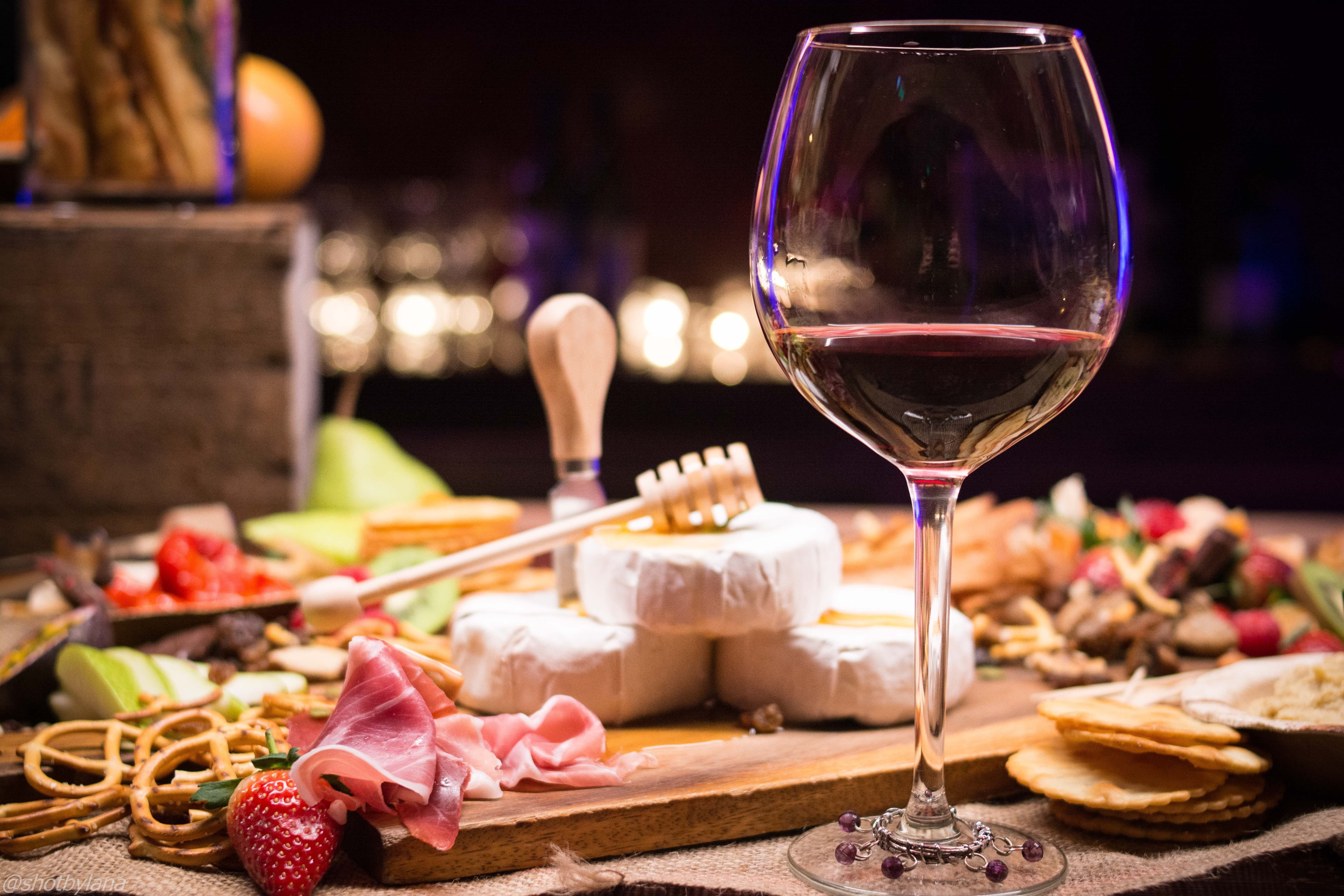 Charcuterie Board with a Glass of Red Wine