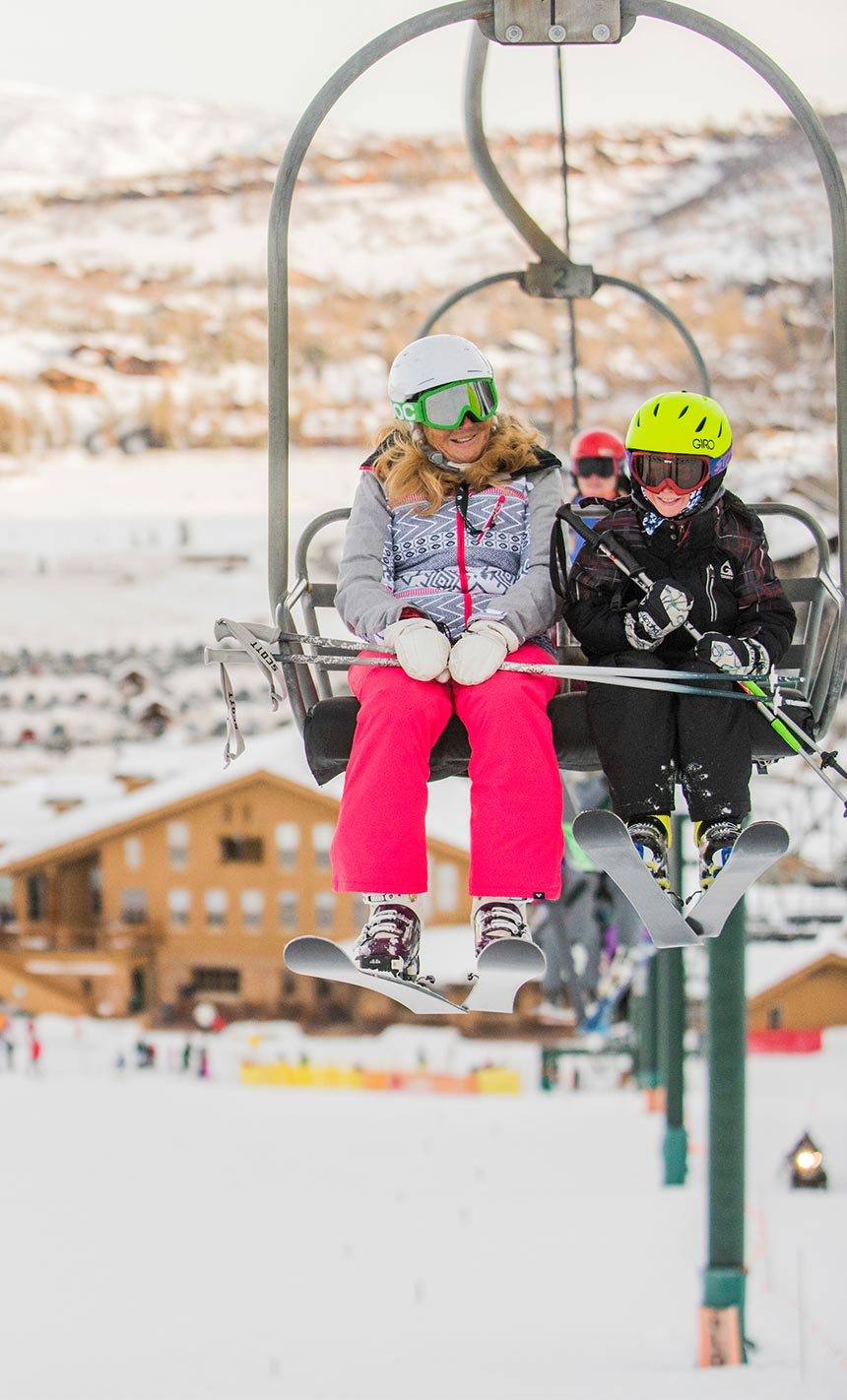 Mother and Child on Ski Lift in Deer Valley