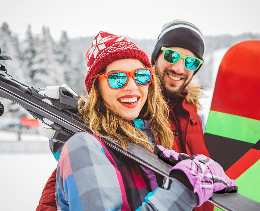 Couple with Skis and Wither Clothes