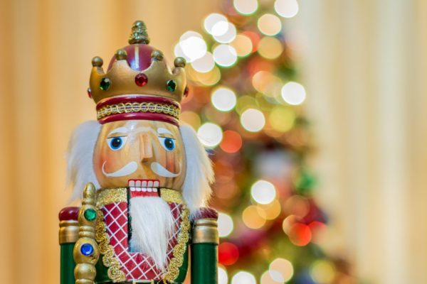 Nutcracker in front of Christmas Tree