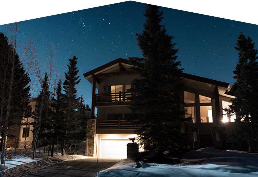 Park City Utah vacation home at night under a starry sky
