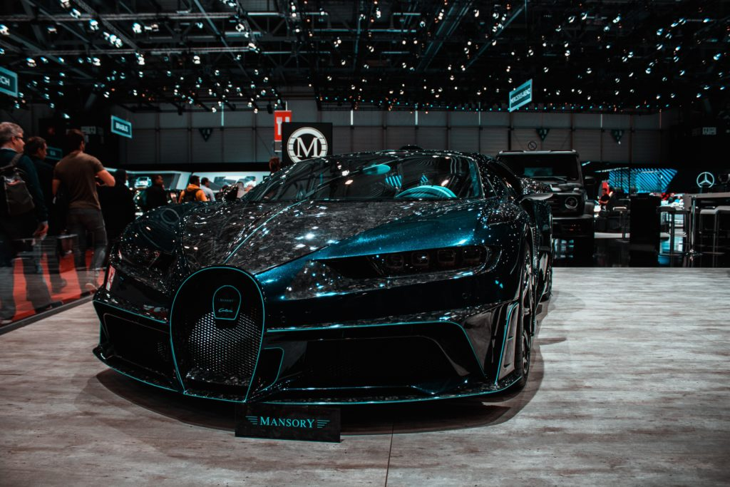 Slick Black Car at Automobile Show