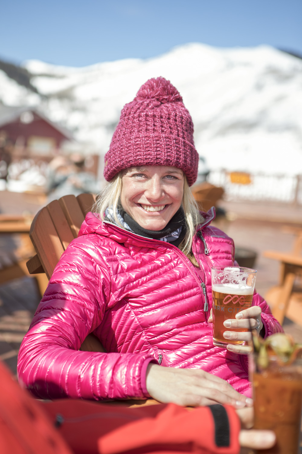 Woman enjoys apres ski at park city mountain resort