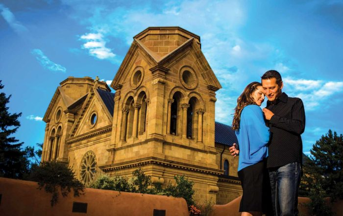 Couple Embracing in front of The Cathedral Basilica of St. Francis of Assisi