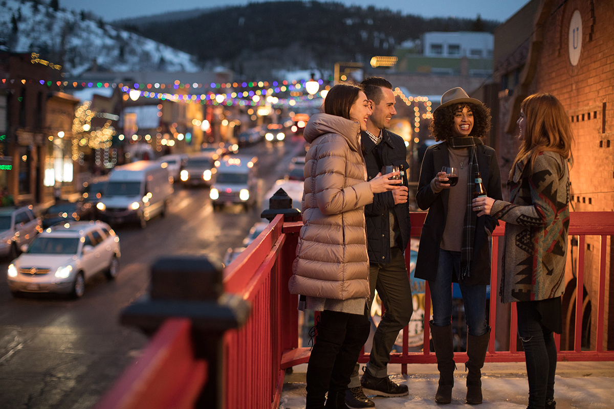 Friends Enjoying Drinks Atop a Patio Above Park City's Historic Main Street
