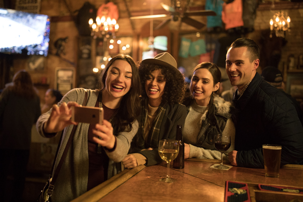 Friend Group taking selfie at bar in park city