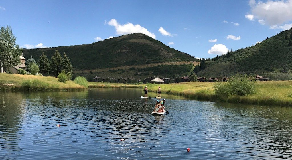 People On Stand Up Paddle Boards at Pebble Beach in Deer Valley