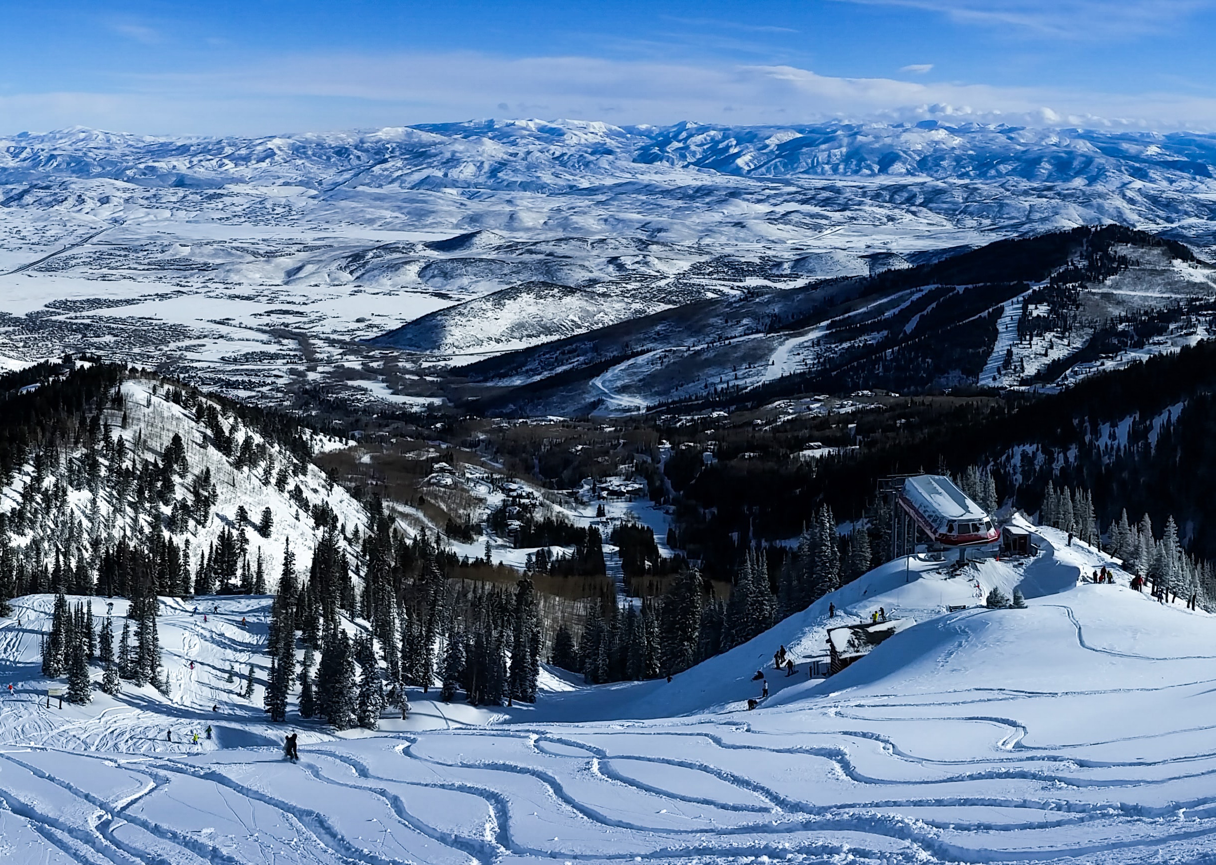fresh power ski tracks on park city mountain resort looking at mountain scape in the background