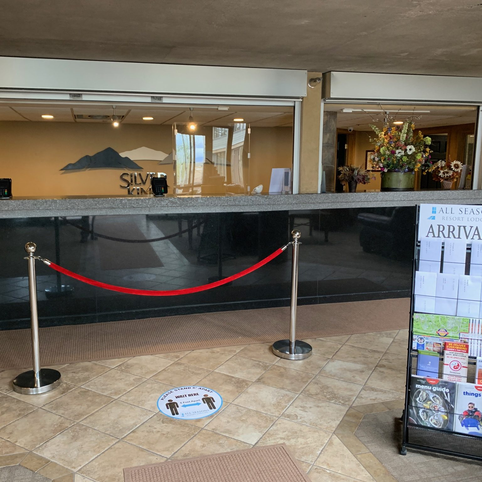 Silver King Hotel's New Front Desk Setup for COVID-19 Safety - Velvet Ropes, Touch-Free Check-In, and Acrylic Barriers