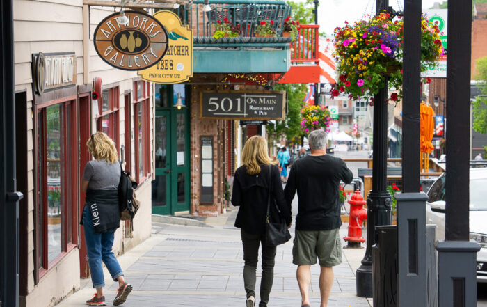 A Couple Enjoying A Walk Down Park City's Summer Main Street