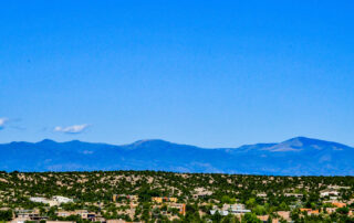 mountain and valley view from fort marcy hotel suites in santa fe new mexico