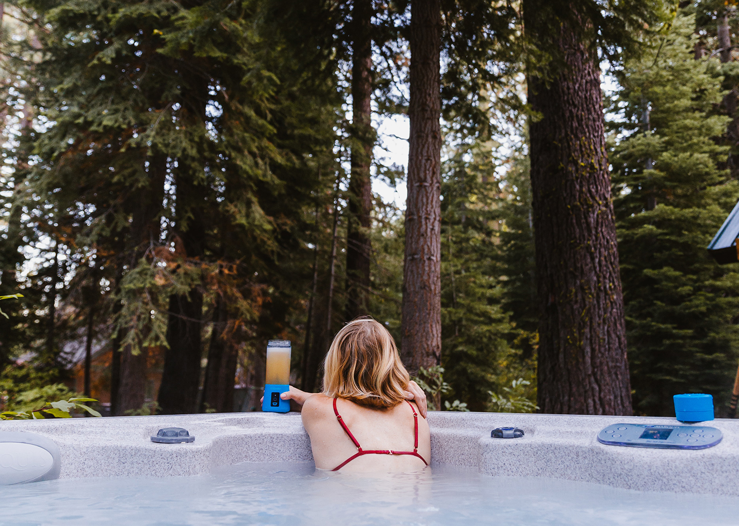 A Woman Stares into the Wilderness From Her Hot Tub