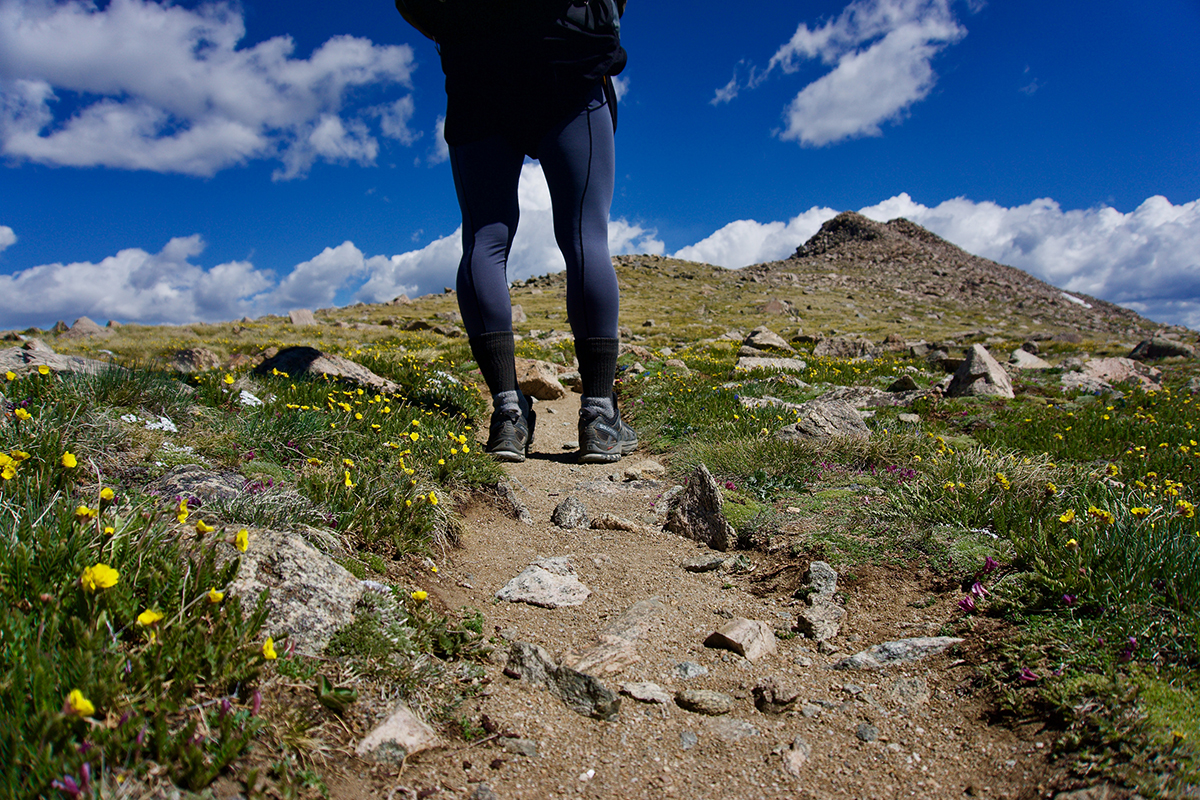 A Woman Enjoying A Hike on a Rocky Trail in Park City